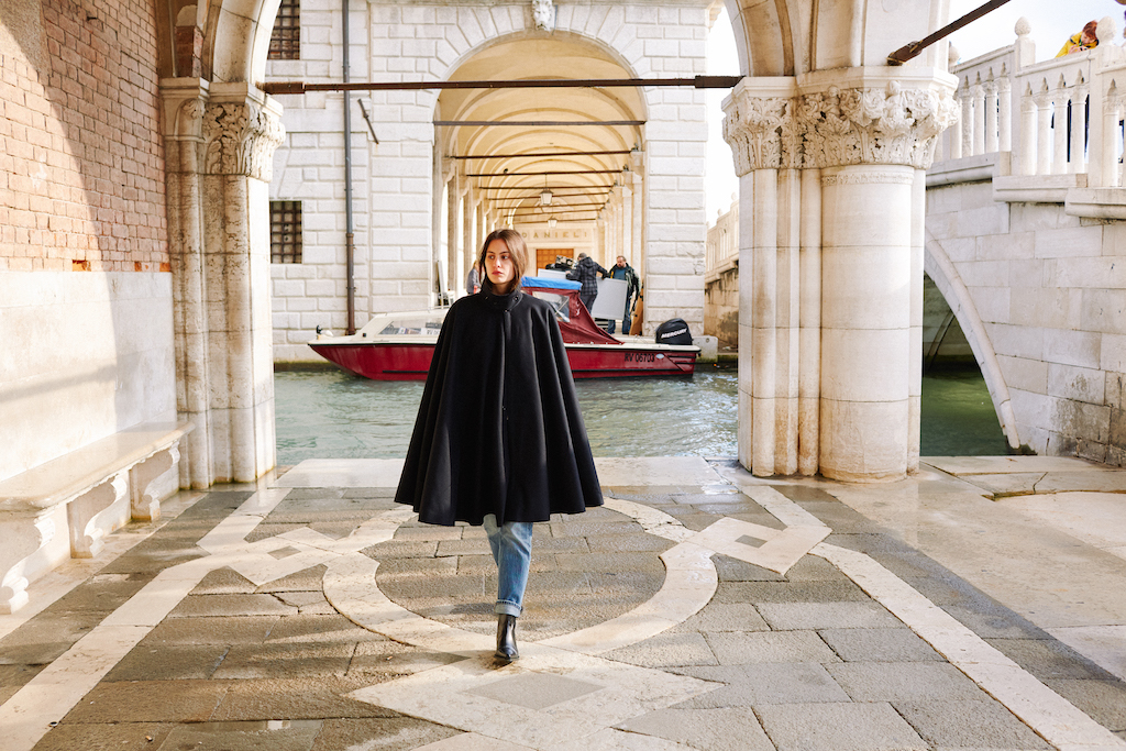 Woman wearing a Tabarro Cloak